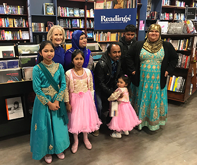 Lyn White with Tara Begum and her family